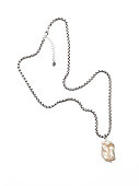 istock Luxury elegant baroque pearl pendant with silver chain isolated on white background 1291384273