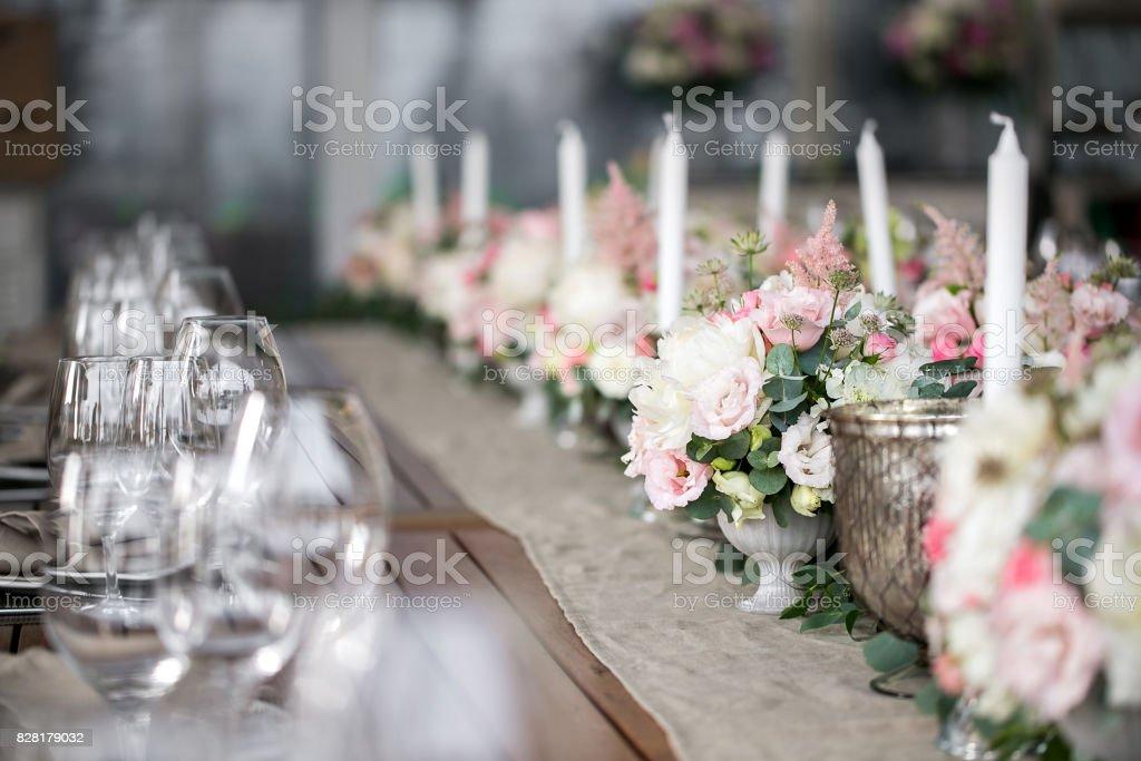 Luxury, elegant wedding reception table arrangement, floral centerpiece stock photo
