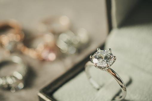 istock luxury engagement Diamond ring in jewelry gift box 980432112