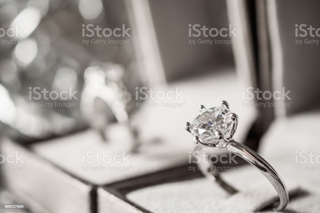 luxury engagement Diamond ring in jewelry gift box with bokeh light background stock photo