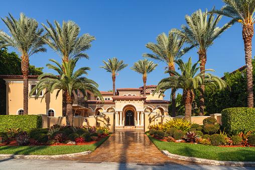 Miami Beach, Florida USA - April 12, 2012: Modern luxury waterfront Mediterranean style estate home located along Biscayne Bay.