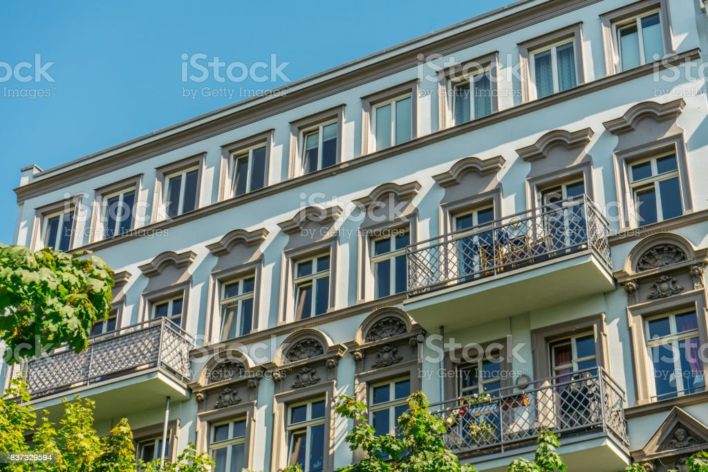 luxury facade with ornaments and steel balconies stock photo