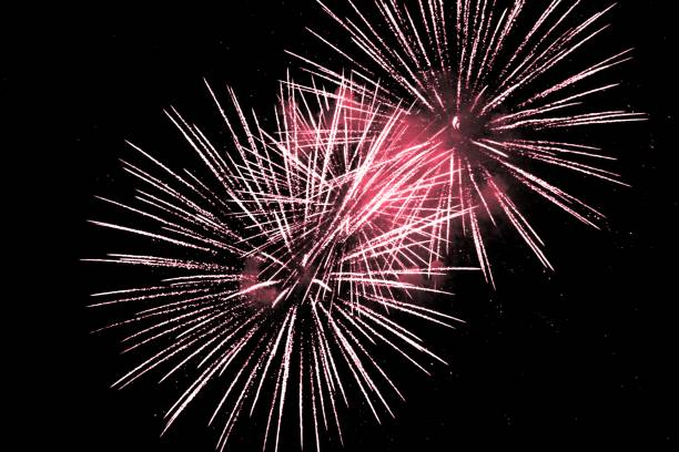 Luxury fireworks event sky show with red big bang stars Premium entertainment magic star firework at e.g. New Years Eve or Independence Day party celebration. Black background copyspace. pyrotechnic effects stock pictures, royalty-free photos & images