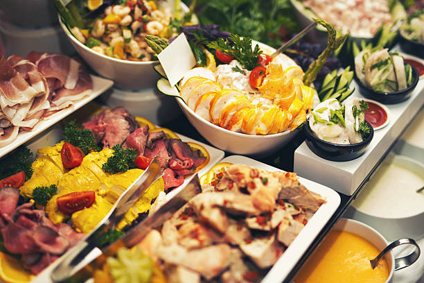 luxury food on wedding table in hotel or restaurant - sideboard imagens e fotografias de stock