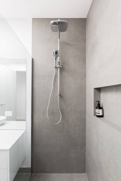 Luxury fully tiled shower with rain head shower rose