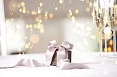 istock Luxury gift box on table. 898548344