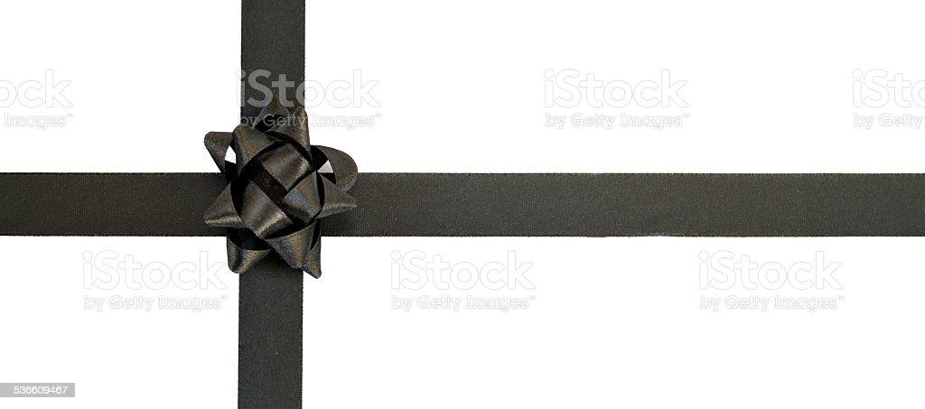 Luxury gift wrap. Black ribbon and bow on white background. stock photo