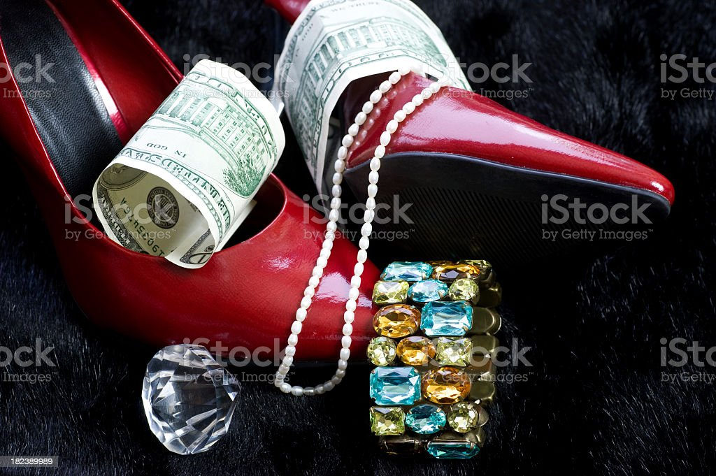 luxury gifts for woman with shoes, dollars and money royalty-free stock photo