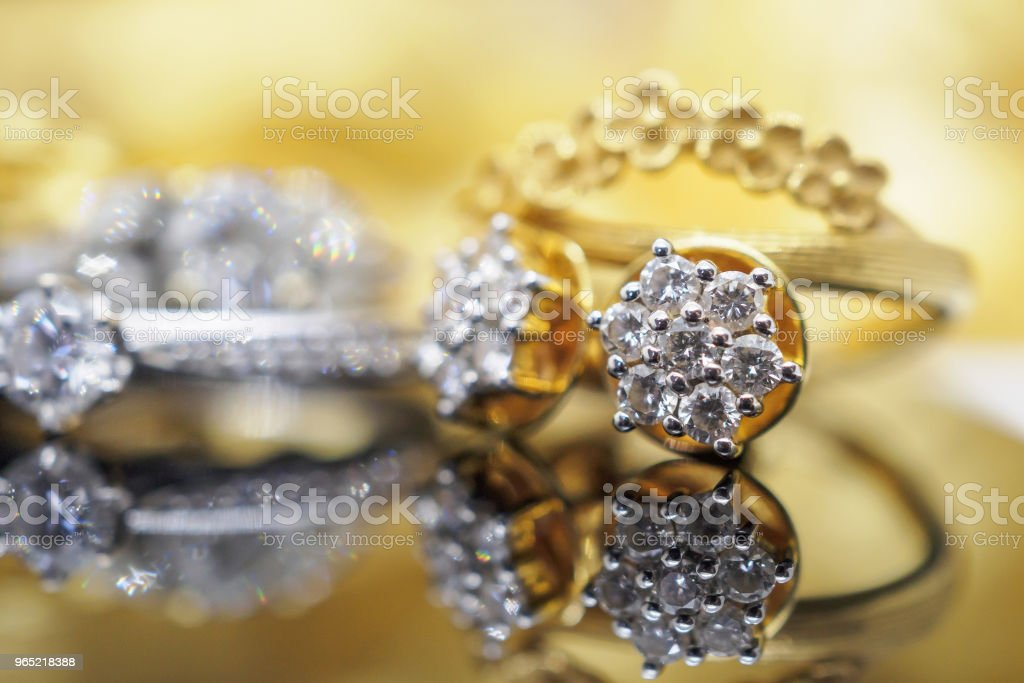 Luxury gold Jewelry diamond earrings with reflection on black background royalty-free stock photo