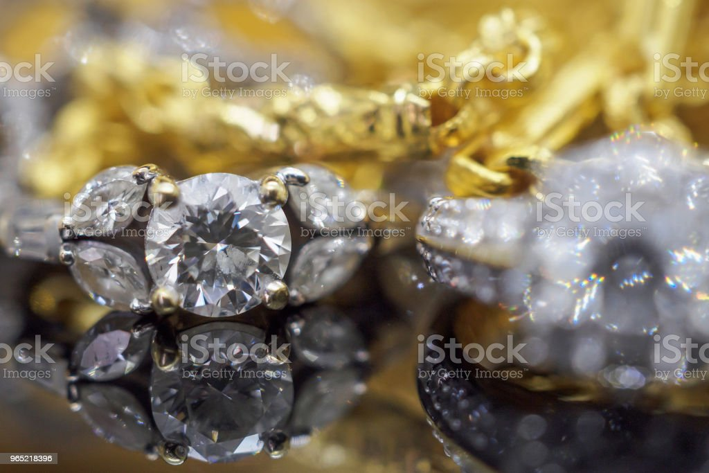 Luxury gold Jewelry diamond rings with reflection on black background royalty-free stock photo