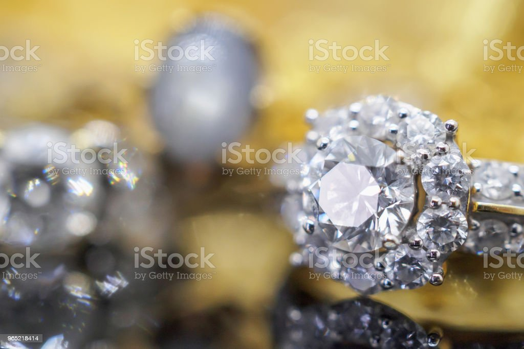 Luxury gold Jewelry diamond rings with reflection on black background zbiór zdjęć royalty-free