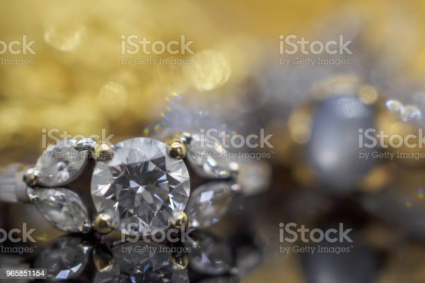 Luxury Gold Jewelry Diamond Rings With Reflection On Black Background Stock Photo - Download Image Now