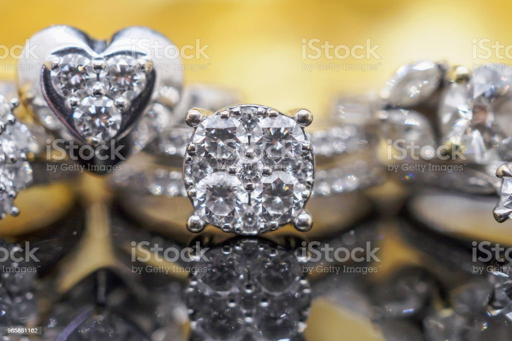 Luxury gold Jewelry diamond rings with reflection on black background - Royalty-free Beauty Stock Photo