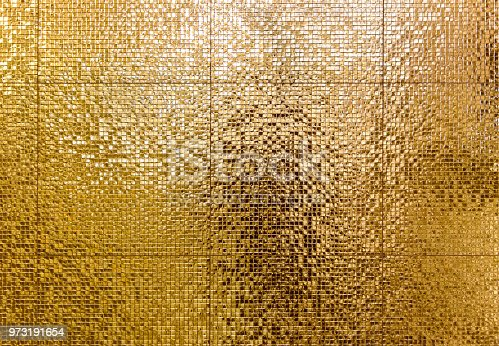 istock Luxury gold mosaic tiles background for bathroom or toilette texture. 973191654
