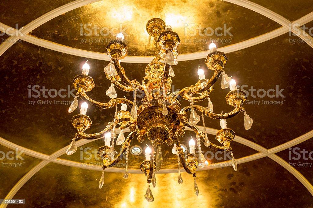 Luxury golden chandelier stock photo