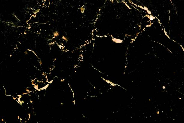 Luxury golden pattern design on black marble stock photo