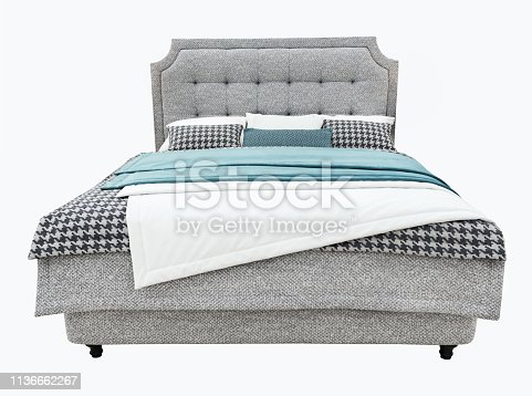 Luxury gray modern bed furniture with upholstery capitone texture headboard and fabric bedclothes. Classic modern furniture with shallow stripe cloth on isolated background.