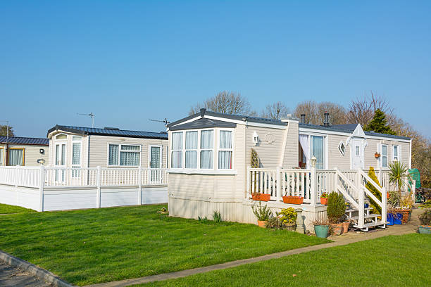 Luxury holiday home on a caravan park - UK Image of an up market holiday home and purpose built steps and decking. manufactured housing stock pictures, royalty-free photos & images