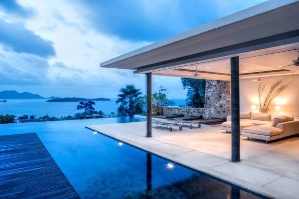 Luxury Holiday Island Villa Home Exterior With Infinity Pool Beautiful Tropical Home At Dusk holiday villa stock pictures, royalty-free photos & images
