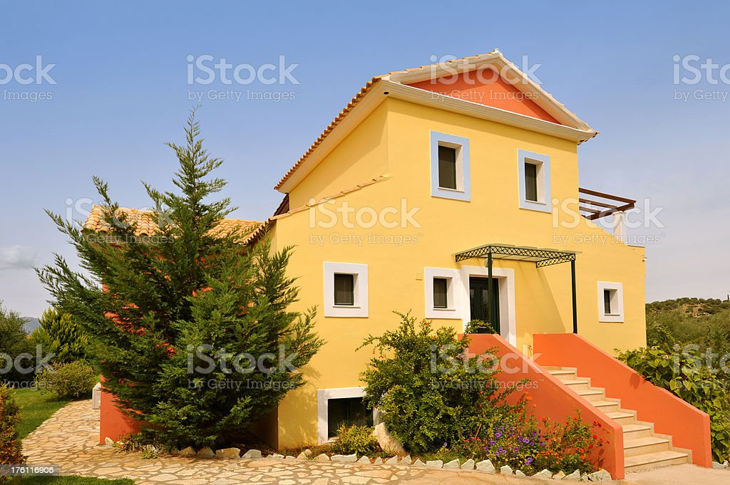Luxury holiday vacation villa exterior with a blue sky royalty-free stock photo