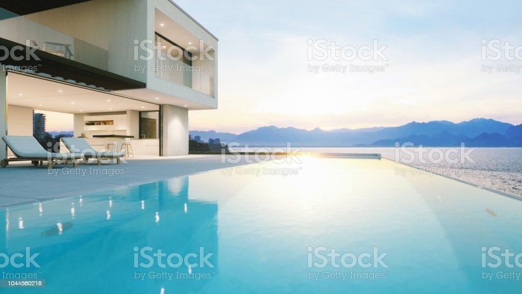 Luxus-Ferien-Villa mit Infinity-Pool bei Sonnenuntergang – Foto