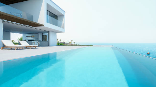 Luxury Holiday Villa With Infinity Pool Modern luxury house with infinity pool over the ocean. holiday villa stock pictures, royalty-free photos & images