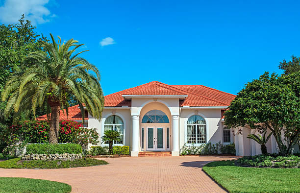 Luxury home and landscaped gardens stock photo