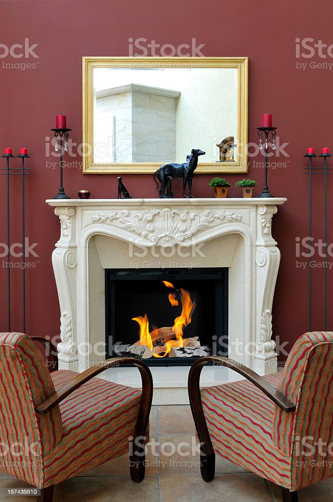 Luxury home interior with classic romantic marble fireplace stock photo
