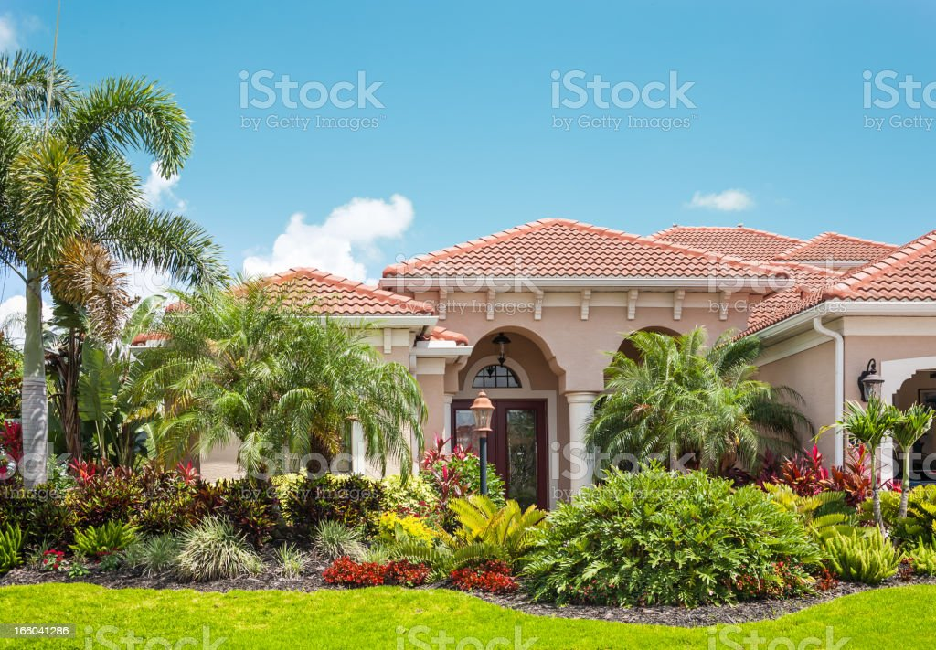 Luxury Home with Lush Tropical Garden stock photo