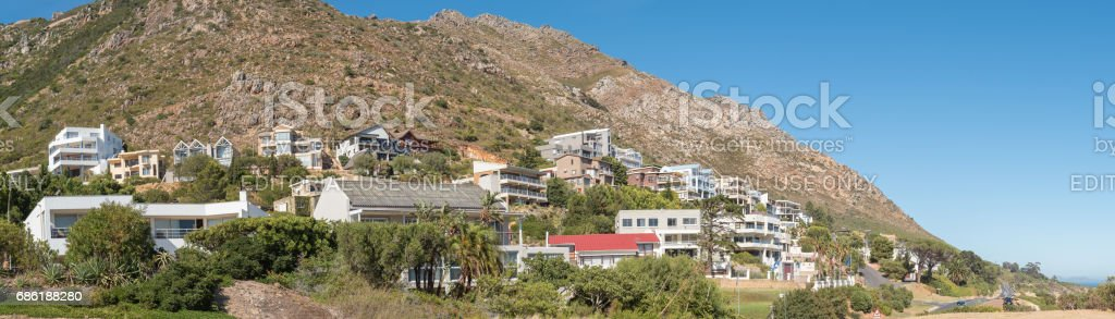 Luxury homes against the Hottentots Holland Mountains in Gordons Bay stock photo