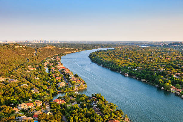 luxury homes, Austin Texas, Colorado River, Mount Bonnell district, aerial luxury homes on Colorado River near Austin TexasAerial view of Luxury homes on Colorado River in Mount Bonnell district in hill country near Austin Texas. City of Austin skyline in distance. colorado river stock pictures, royalty-free photos & images