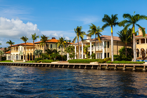 Luxury waterfront homes along the Fort Lauderdale intracoastal waterway viewed from a yacht.