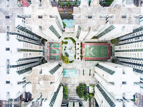 istock Luxury Hong Kong apartments aerial view with sport courts inside 908370992