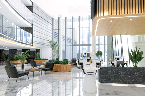 Luxury Hotel Lobby With Smart Robots Working As A Receptionist And Waiter.