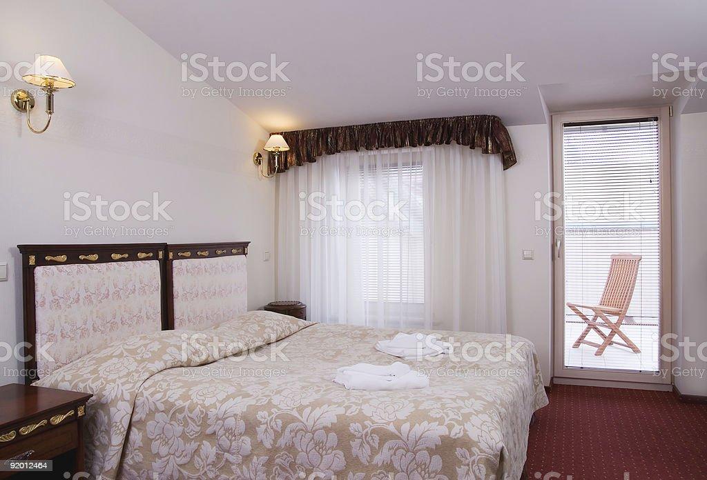 Luxury hotel room with a balcony royalty-free stock photo