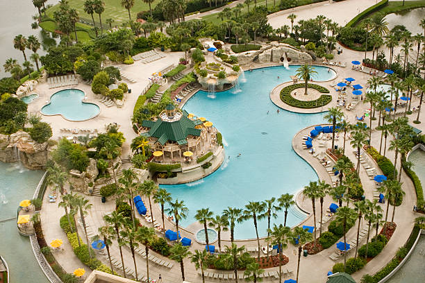 luxury hotel swiming pool - kissimmee stock photos and pictures