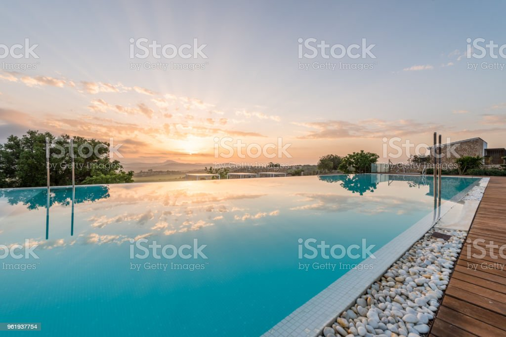 Luxury hotel swimmin pool in the morning stock photo