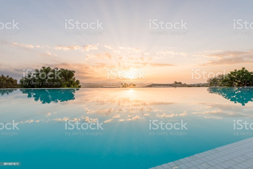 Luxury hotel swimmin pool in the morning Big and nice luxury swimming pool from an hotel in the sunrise in the morning Architecture Stock Photo