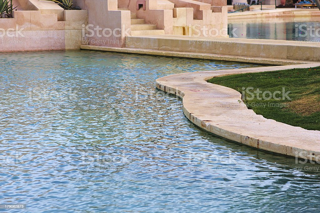 Luxury hotel swimming pool in the evening royalty-free stock photo