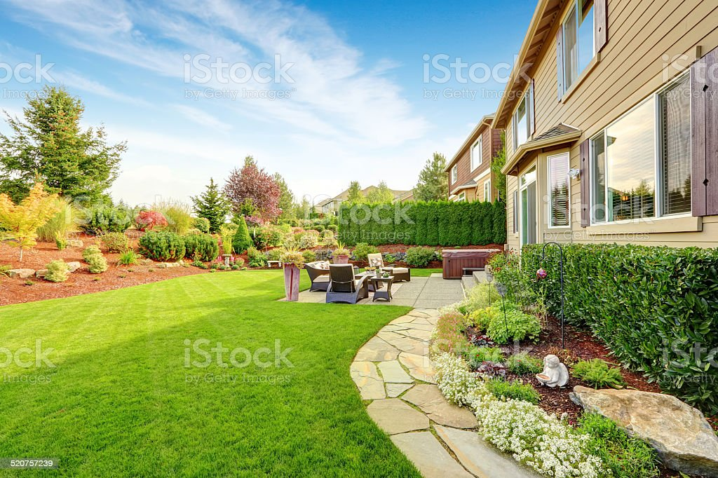 Luxury house exterior with impressive backyard landscape design stock photo