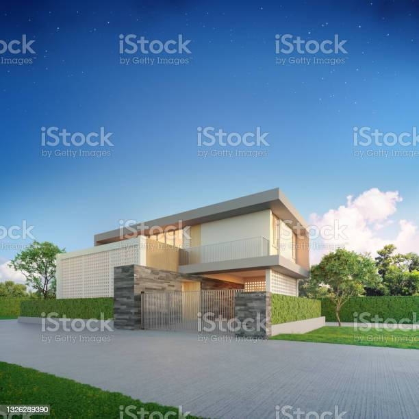 Photo of Luxury house in modern design. Green grass lawn at vacation home.