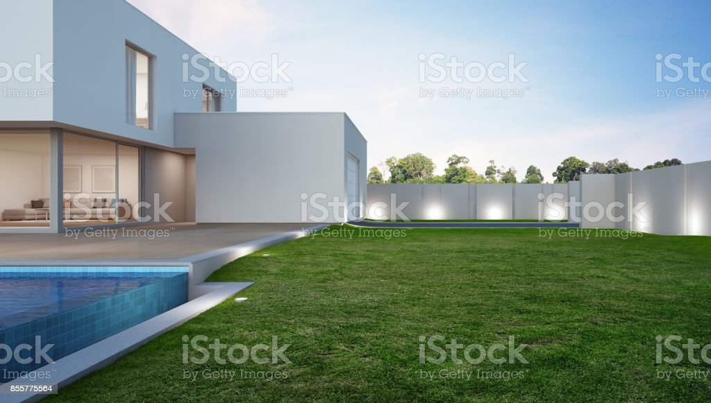 Luxury house with swimming pool and terrace near lawn in modern design, Vacation home or holiday villa for big family stock photo