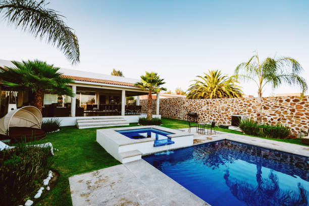 Luxury house with swimming pool - property in Latin America Luxury property in Latin America backyard pool stock pictures, royalty-free photos & images