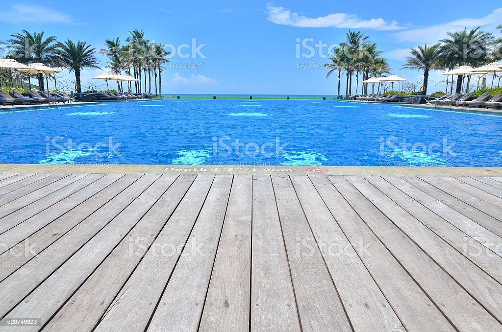 Luxury infinity swimming pool at tropical resort stock photo