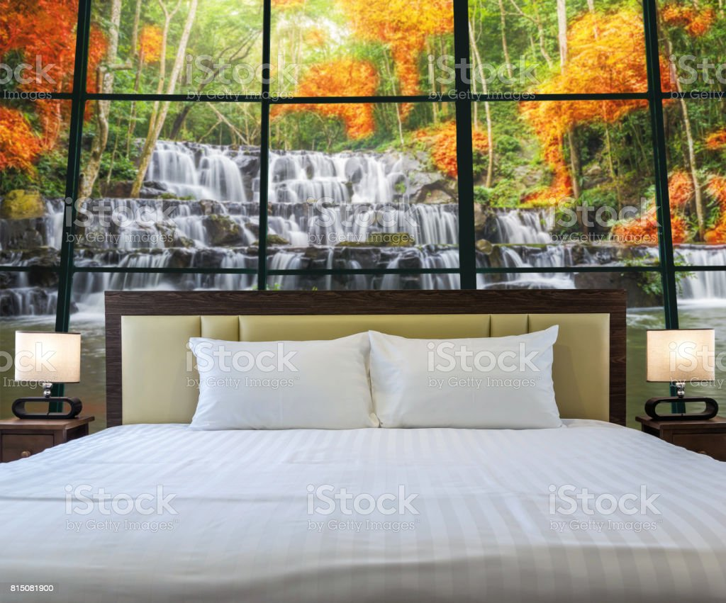 Luxury Interior bedroom with windows glass beside Beautiful waterfall in the deep forest, relax and holiday concept, dicut each elements stock photo