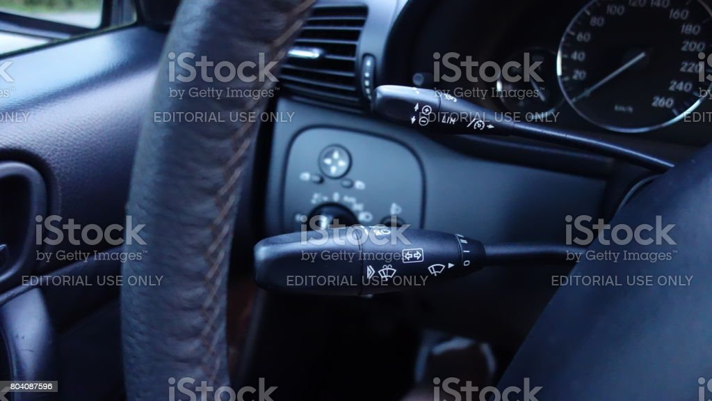 Luxury interior driver's commands - turn left or right signal lever, cruise control stock photo