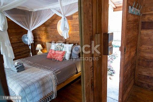 Luxury island cabin bedroom and private outdoor bathroom
