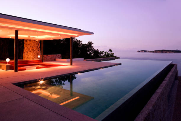 Luxury Island Villa Home In The Tropics Along The Coastline At Sunrise Indoor Outdoor Tropical Chalet With Infinity Pool And Ocean View infinity pool stock pictures, royalty-free photos & images
