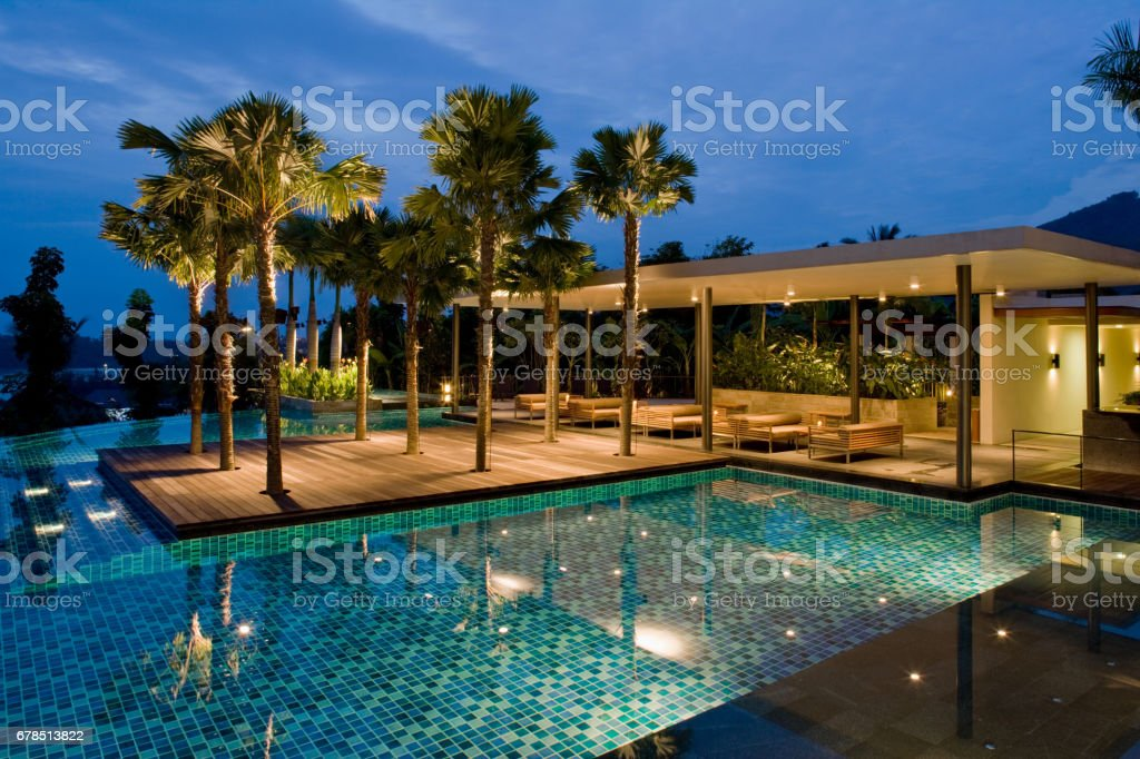 Luxurious Tropical Home With Infinity Pool At Twilight