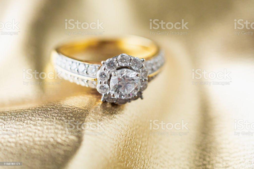 luxury jewelry diamond ring on gold background